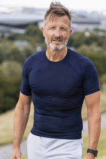 Portrait of a sporty man standing outside - DIGF07508