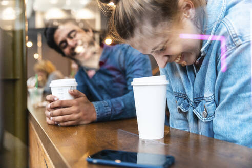Friends having fun together in a coffee shop - WPEF01616