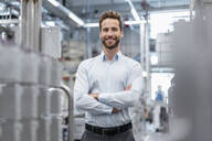 Portrait of a confident businessman in a modern factory - DIGF07568