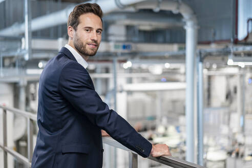 Portrait of a confident businessman in a factory - DIGF07598