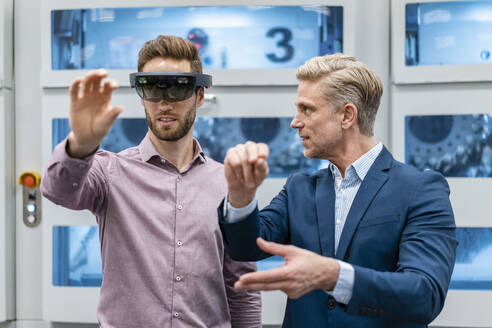 Two businessmen with AR glasses in a modern factory - DIGF07628