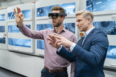 Two businessmen with AR glasses in a modern factory - DIGF07694