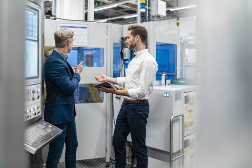 Two businessmen talking in a modern factory - DIGF07712
