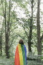 Rear view of a woman covered in a rainbow flag - AHSF00593
