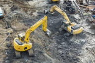 Aerial view of diggers at construction site - BLEF10300