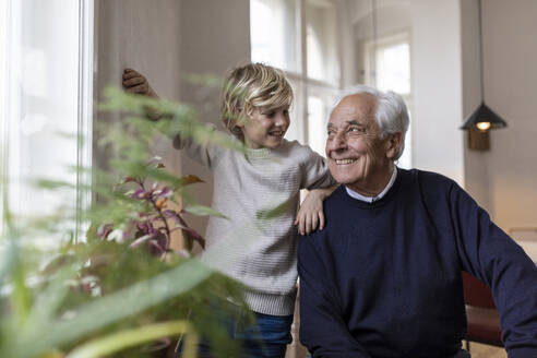 Happy grandfather and grandson at home - GUSF02083