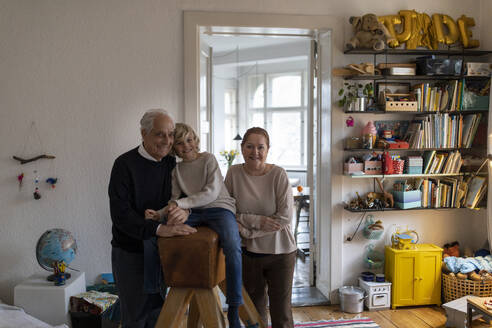 Portrait of happy grandparents with grandson at home - GUSF02119
