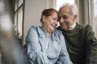 Portrait of happy senior couple at home - GUSF02203