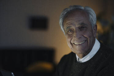 Portrait of smiling senior man at home - GUSF02212