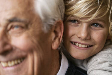 Close-upof happy grandson hugging grandfather - GUSF02272