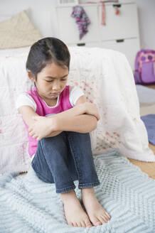 Vietnamese girl pouting in bedroom - BLEF10320