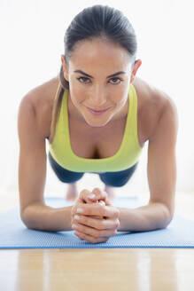 Caucasian woman exercising on yoga mat - BLEF10455