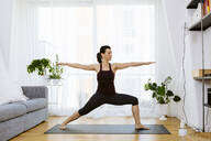 Woman practicing yoga at home - SODF00021