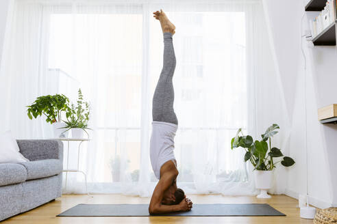 Woman practicing yoga at home - SODF00024