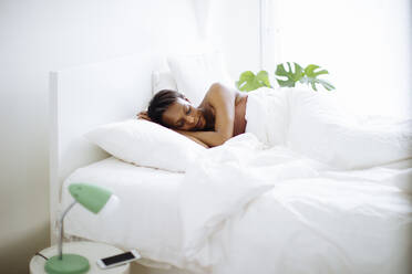 Woman sleeping in bed at home - SODF00042