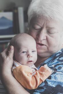 A grandmother holding her baby grandson, Hamburg, DE - IHF00189