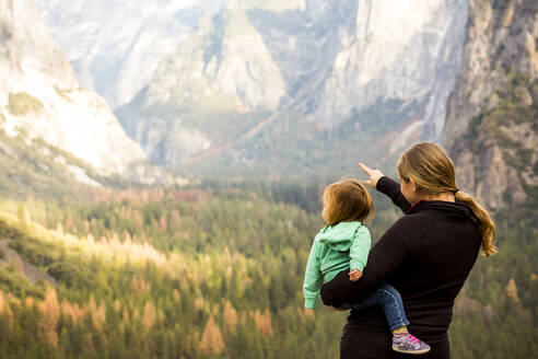 Caucasian mother and daughter in Yosemite National Park, California, United States - BLEF10626