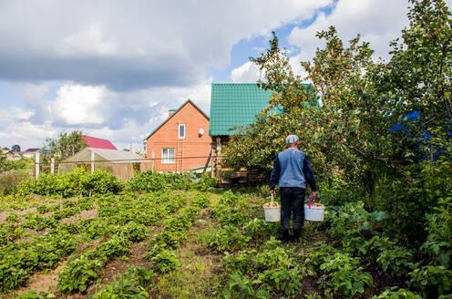 Caucasian farmer working in garden - BLEF10659