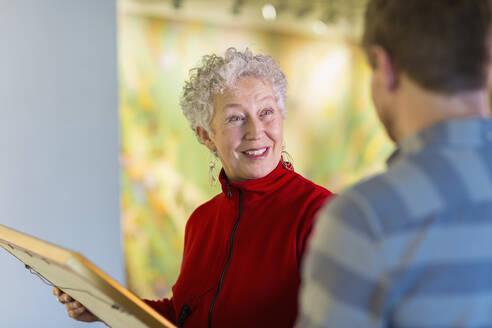 People talking in art gallery - BLEF10849
