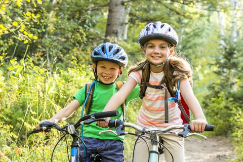 Caucasian children riding mountain bikes - BLEF10978