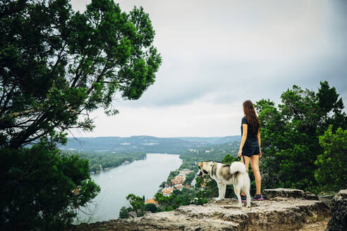 Caucasian woman and dog admiring scenic view - BLEF11191