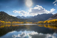 Mountains reflecting in remote lake - BLEF11383