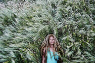 Black woman laying in grass - BLEF11689