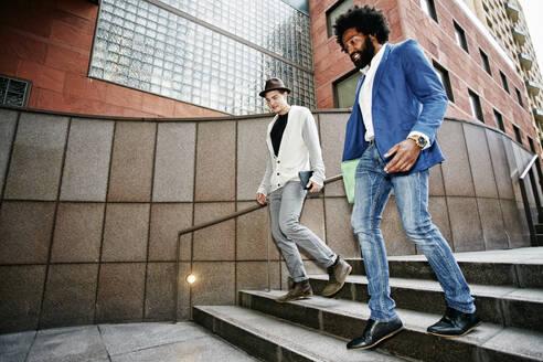 Businessmen talking on steps - BLEF11737