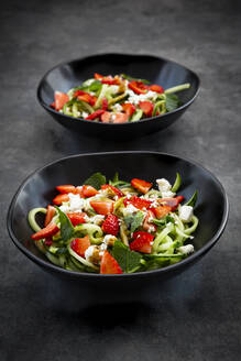 Bowls of strawberry cucumber salad with feta, mint and balsamico vinegar - LVF08192