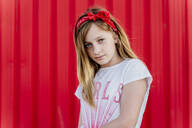 Portrait of girl with hair-band in front of red wall - ERRF01611
