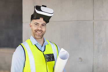 Architect with VR glasses at construction site - ZEF16140
