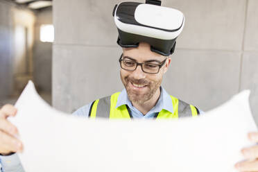 Architect with VR glasses at construction site - ZEF16143
