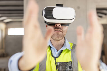 Architect with VR glasses at construction site - ZEF16146