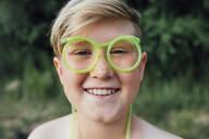 Portrait of freckled boy with funny glasses - VPIF01391