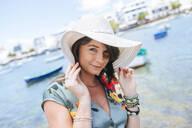Woman with white sun hat in Arrecife, Spain - KIJF02519