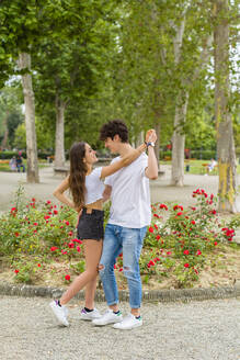 Young couple dancing in a park - MGIF00623