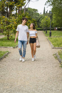 Young couple walking together in a park - MGIF00635