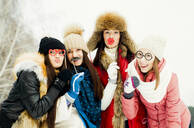Caucasian girls playing with disguises in snow - BLEF12070