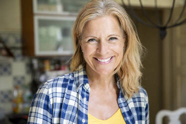 Portrait of smiling mature woman at home - FMKF05754