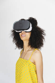Young woman wearing virtual reality glasses - MRAF00414