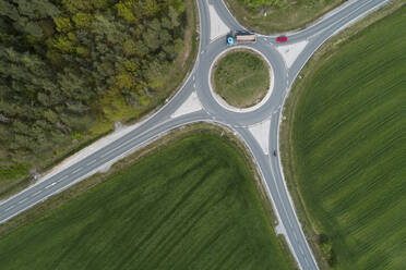 Aerial view of roundabout intersection with traffic. Franconia, Bavaria, Germany. - RUEF02269