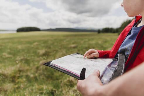 Scotland Uk Boy reading a map - NMS00333