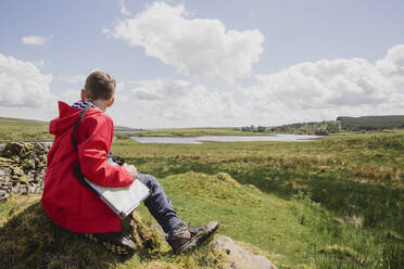 Boy with map looking at view, Cairngorms, Scotland, UK - NMS00336