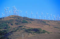 Wind turbines on hilltop in remote landscape - BLEF12115