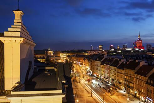 Poland, Warsaw, Krakowskie Przedmiescie street, capital city cityscape at evening twilight - ABOF00428