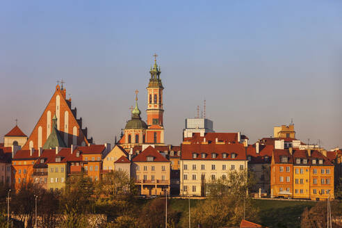 Old Town houses and churches at sunrise, Warsaw, Poland - ABOF00431