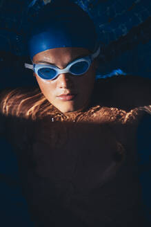 Portrait young paralympic swimmer in the pool - JCMF00073