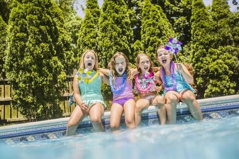Caucasian girls cheering at swimming pool - BLEF12200