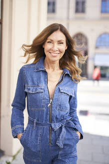 Mature woman wearing denim jumpsuit - PNEF01760