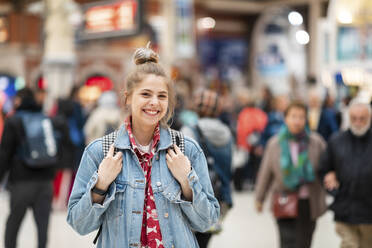 Portrait of happy young woman at the train station - WPEF01647